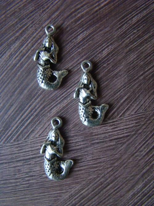 Kovový komponent - mořská panna
