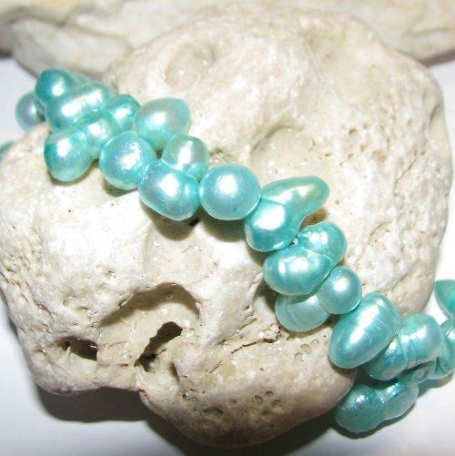 PR215 - Říční perly tyrkysové 10x7 - 15x8 mm