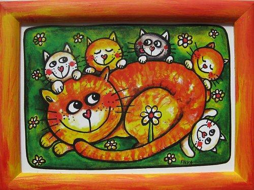 Kočky v trávě