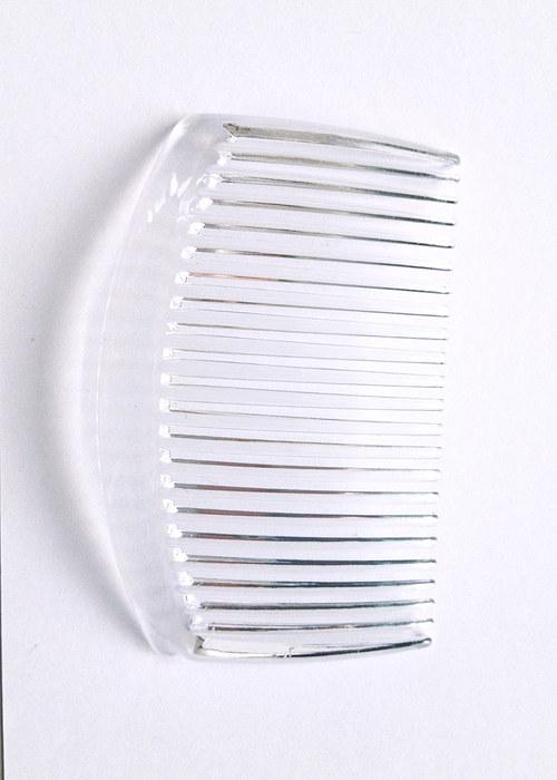 průsvitný plastový hřebínek do vlasů