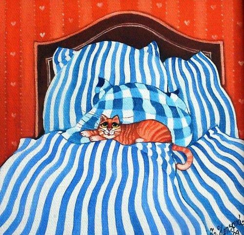 Kočička v modrých peřinách