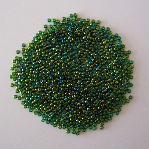 Skleněné korálky - rokajl 10/0 tm.zelený s rainbow