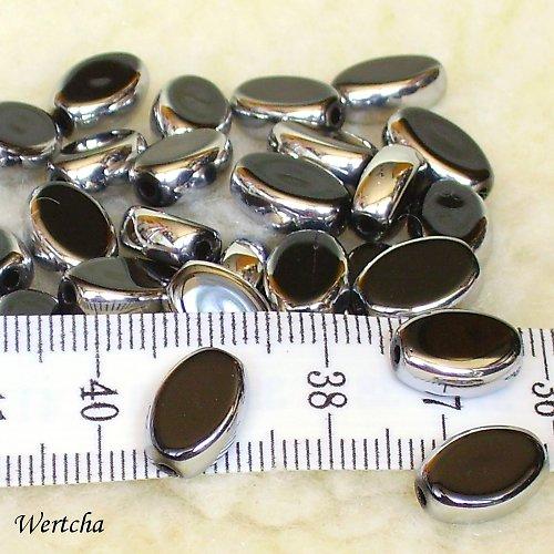 Černé oválky se stříbrným pokovem