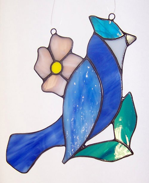 Ptáček s květinou