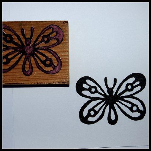 Razítko motýlek