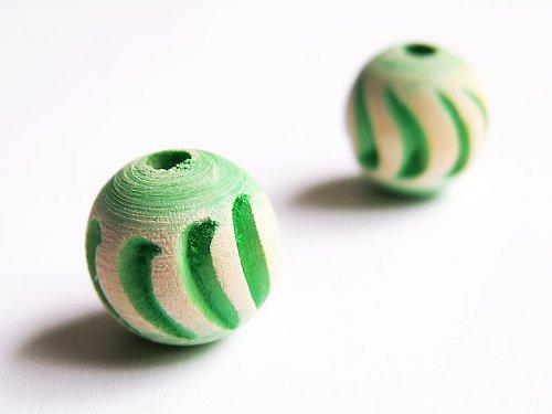 Zelená vyřezávaná kulička ((D27))