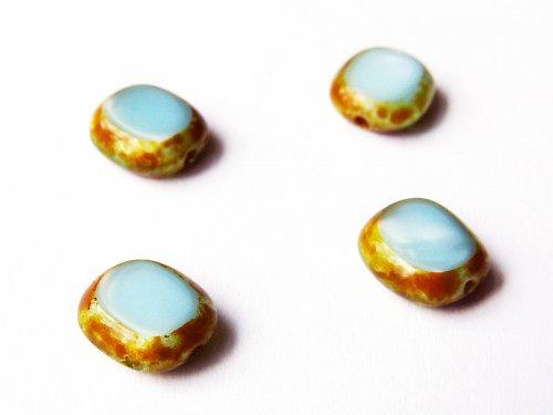 Malé modré oválky s karamelovým pokov.(ploškované)