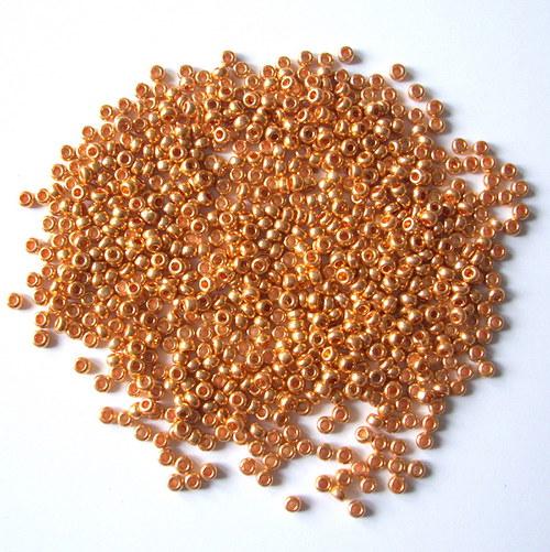 Skleněné korálky - rokajl 9/0 zlatý do oranžova