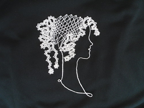 Paličkovaná hlava panny