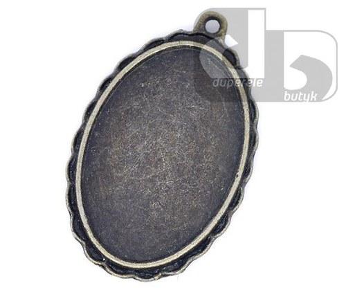 Bronzový oválný medailonek s lůžkem pro pryskyřici