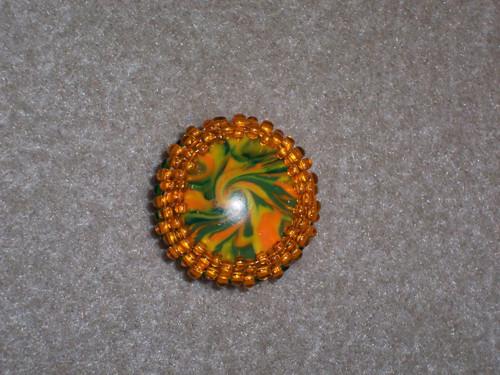 Brož  zelenooranžová