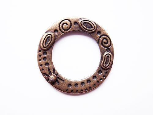 Zdobený kruh ((O52))
