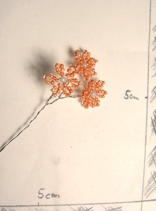 Kytička korálková sv.oranž.tři květy