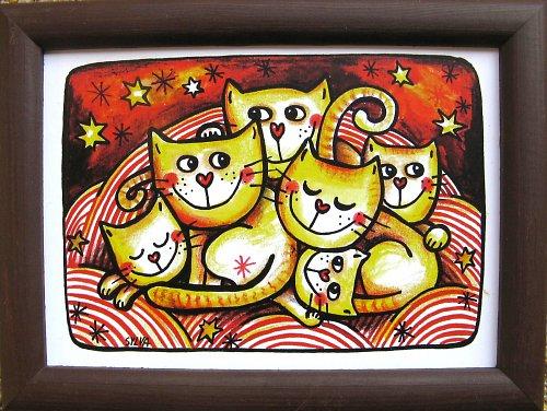 Kočky v peřinách