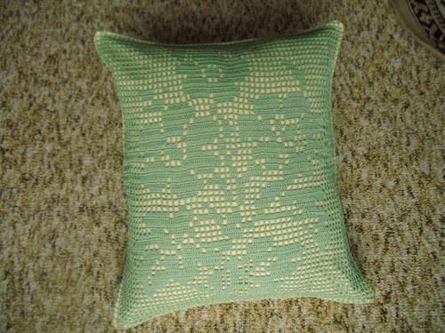 Zelený květinový polštář