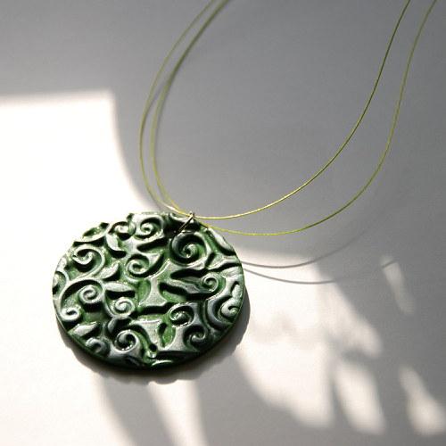 Zelená reliéfní placka