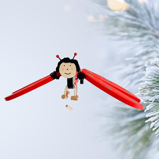 létající beruška dřevěná hračka
